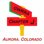 Gold Wing Road Riders Association Colorado Chapter J, Aurora, Colorado. Two red street signs on single gold post. Top sign says GWRRA, bottom says Chapter J.
